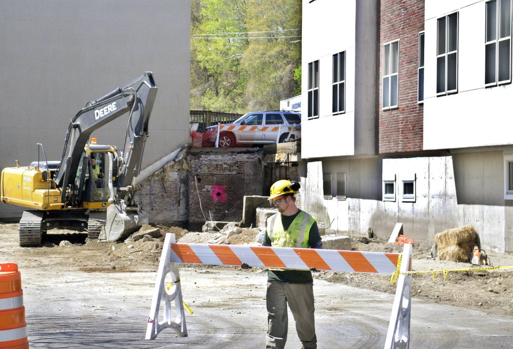 SPRUCING UP: Construction has commenced on the south side of Market Square in downtown Augusta, where officials and merchants hope a grassy park will encourage people to spend more time in the heart of the city.