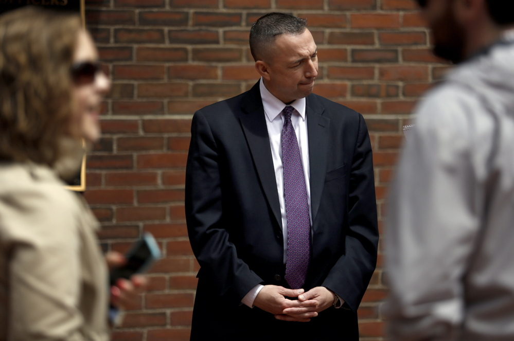 "Portland Police Chief Michael Sauschuck talks with a reporter Tuesday after a news conference. Officials sought to reinforce residents' sense of security after a report said three violent gangs operate in the city. ""I take umbrage with the characterization. ... That is not the case in any way,"" he said."