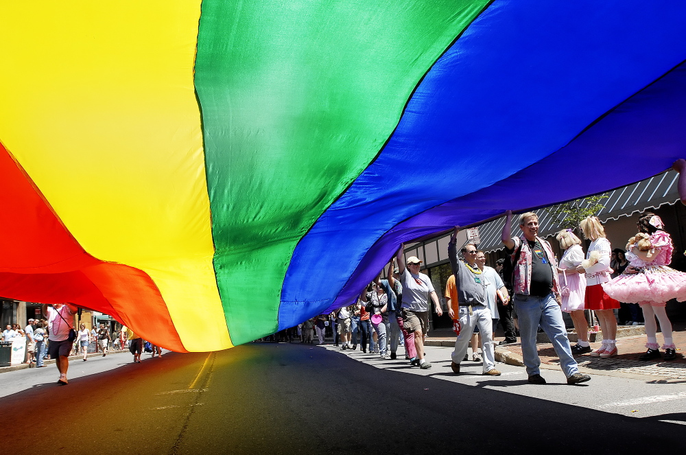 Participants in the gay pride parade six years ago march down Congress Street carrying an enormous rainbow flag, a symbol of the LGBT community.