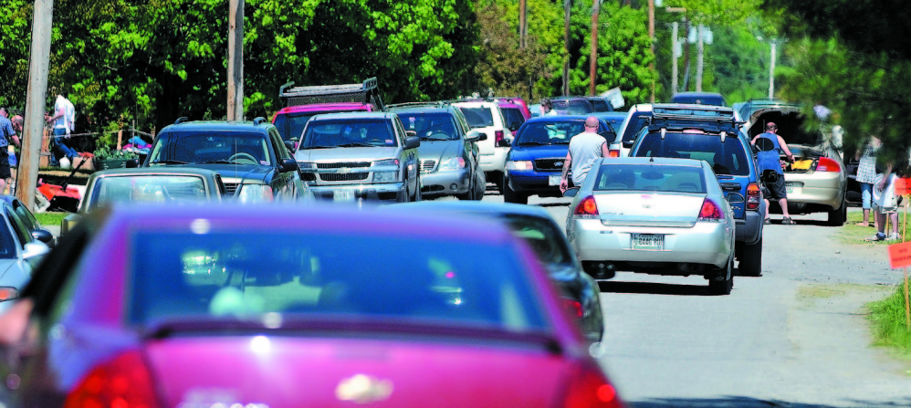 NOT A PARKING LOT: Traffic comes to a near stand-still at the annual 10-mile yard sale down West Ridge Road in Cornville to Malbons Mills Road in Skowhegan in this May 2012 photo.