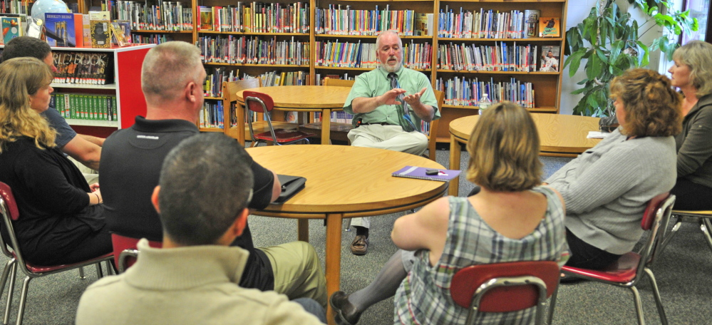 Staff photo by Joe Phelan SOMETHING TO REPORT: Richmond Middle and High School principal Steven Lavoie speaks to a small group of parents during a meeting Thursday in the Richmond Middle School library.