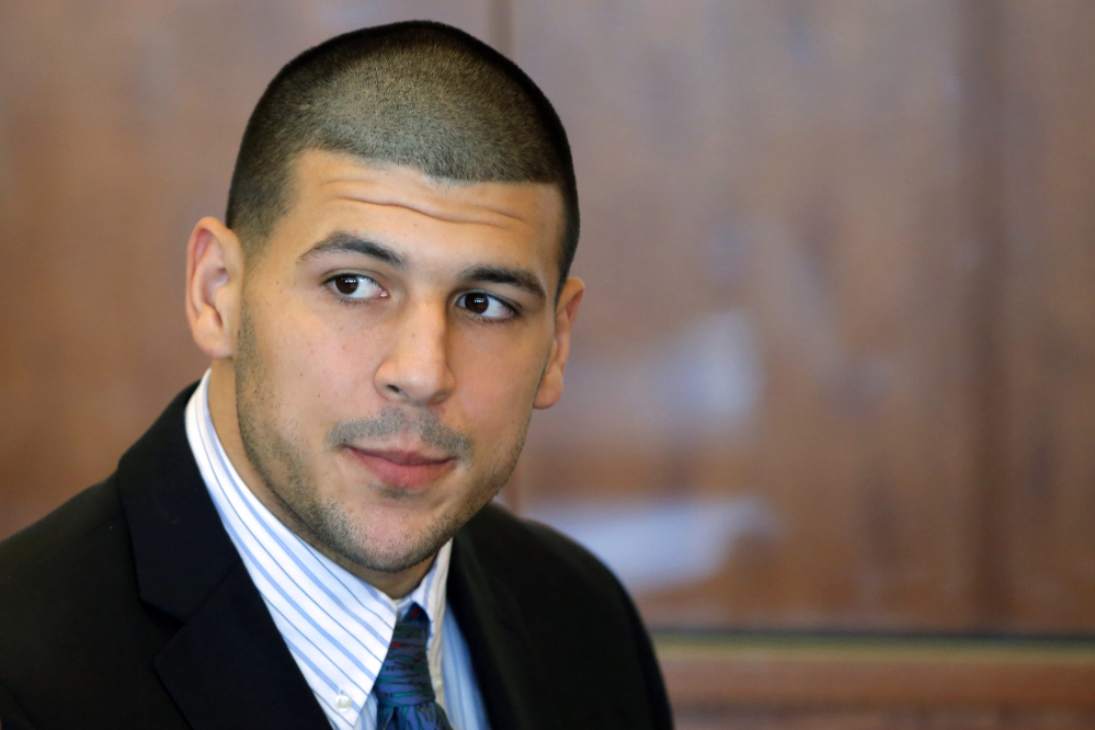 Former New England Patriots NFL football player Aaron Hernandes, who already faces a murder charge in a man's shooting death last year, was indicted Thursday on new murder charges in an unrelated 2012 double slaying in Boston.
