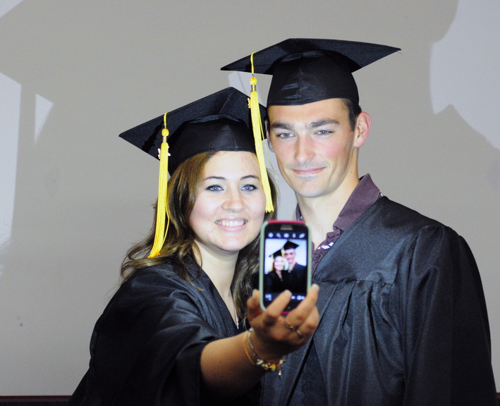 GOAL ACHIEVED: Sonja Hall, left takes a photo with one of her physical therapy assistant classmates, Austin Merrill, before their Kennebec Valley Community College graduation on Saturday at the Augusta Civic Center.