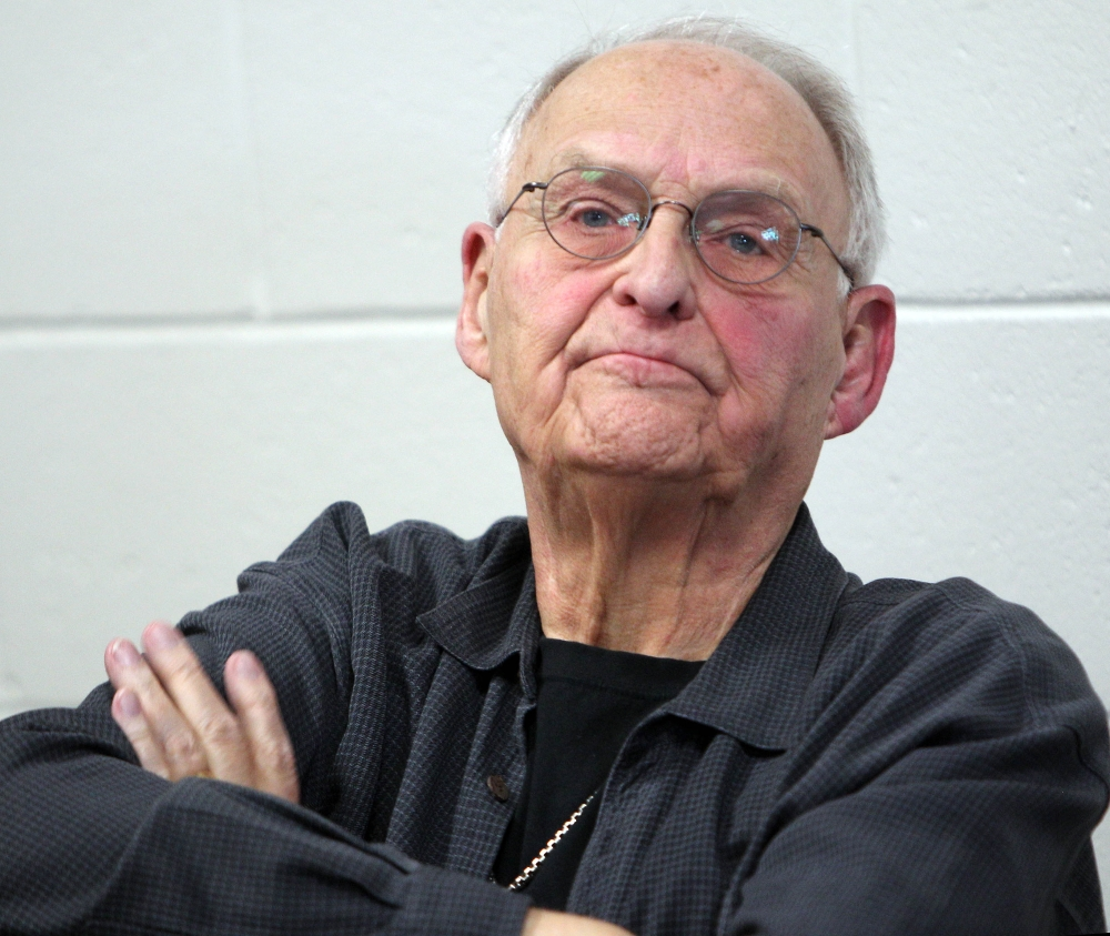Wolfeboro, N.H., Police Commissioner Robert Copeland listens Thursday as town residents ask for his resignation after he was overheard using a racial slur to refer to President Barack Obama at a restaurant.