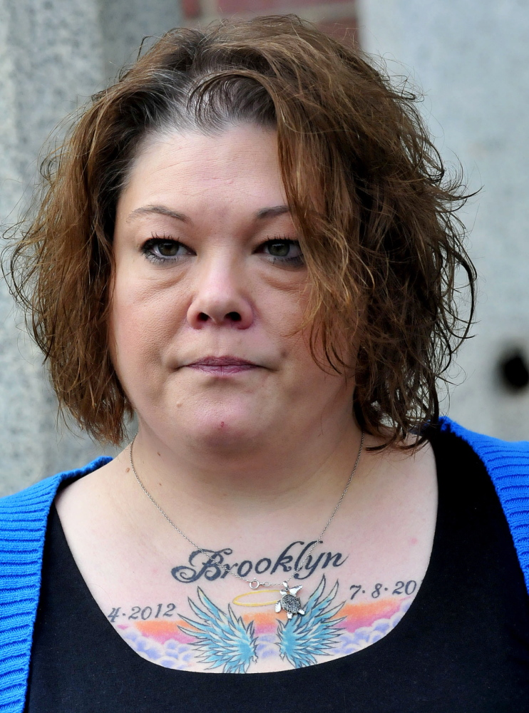 Anger: Nicole Greenaway displays a tattoo in memory of her daughter, Brooklyn, showing the birth and death dates of the 3-month-old.