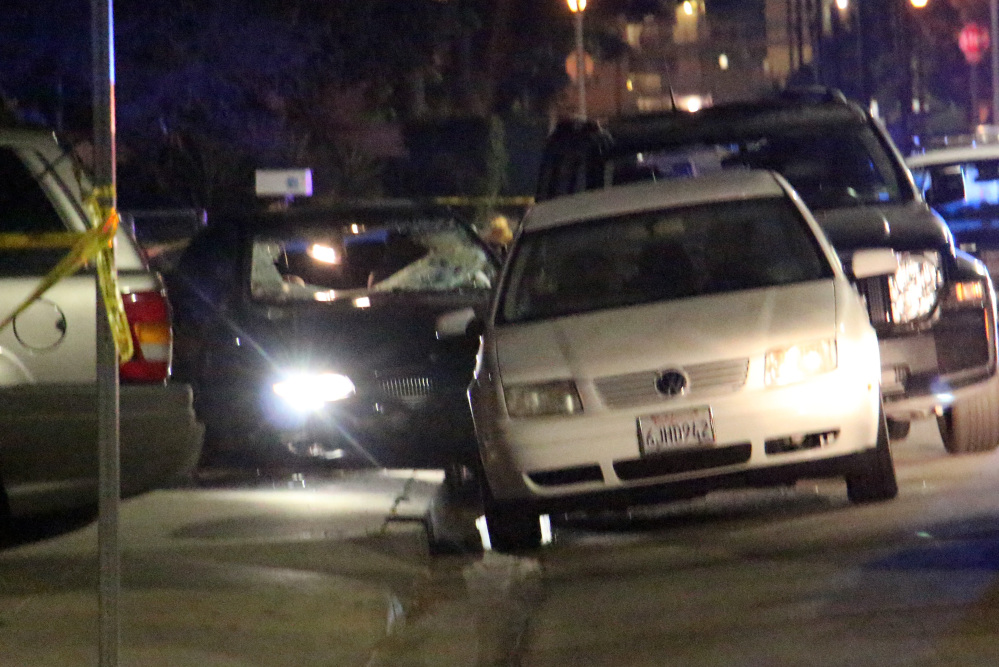 "In this image provided by KEYT-TV, a car window is shot out after a mass shooting near the campus of the University of Santa Barbara in Isla Vista, Calif., late Friday night. A drive-by shooter went on a ""mass murder"" rampage near the Santa Barbara university campus that left seven people dead, including the attacker, and seven others wounded, authorities said Saturday."