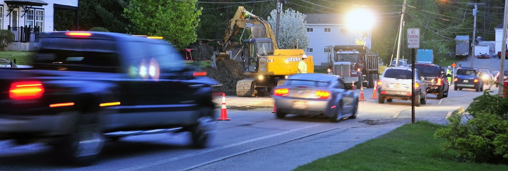 Night Work: Flaggers alternate the direction of traffic flow in one lane through an overnight construction zone Wednesday on Mount Vernon Avenue in Augusta.