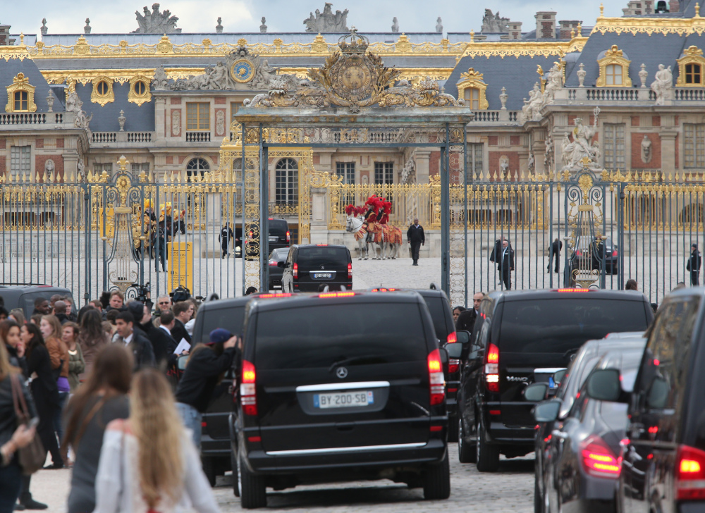 Fans gather to watch guests arriving, as they look inside one of the cars for Kim Kardashian, Kanye West and their guests, at the entrance of the Chateau de Versailles in Versailles, France, west of Paris, on Friday. The gates of the Chateau de Versailles, once the digs of Louis XIV, will be thrown open to Kim Kardashian, Kanye West and their guests for a private evening on the eve of their marriage.
