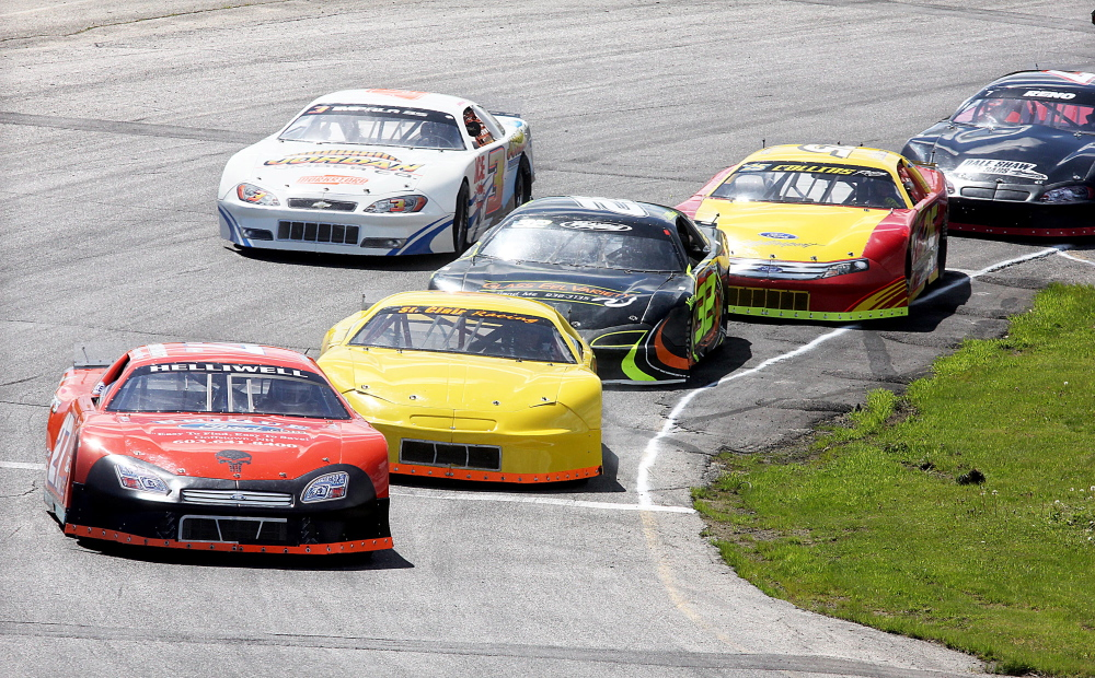 A BATTLE FOR THE LEAD: Dave St. Clair, of Liberty, second from left, battles for the lead with Wayne Helliwell Jr., of Dover, N.H., during a Late Model qualifying heat for the Coastal 200 at Wiscasset Speedway on Sunday.