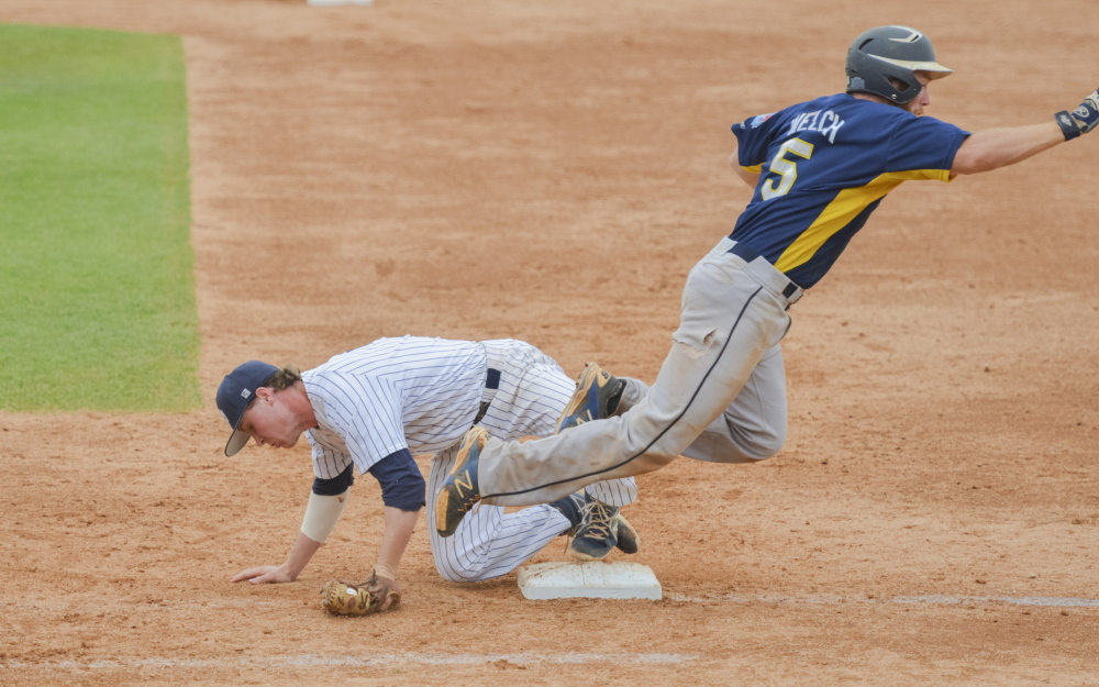 University of Southern Maine second baseman Paul McDonough goes to the ground to field a throw at first base during the sixth inning of a 15-3 loss to Emory University on Monday in the NCAA Division III championships in Appleton, Wis.