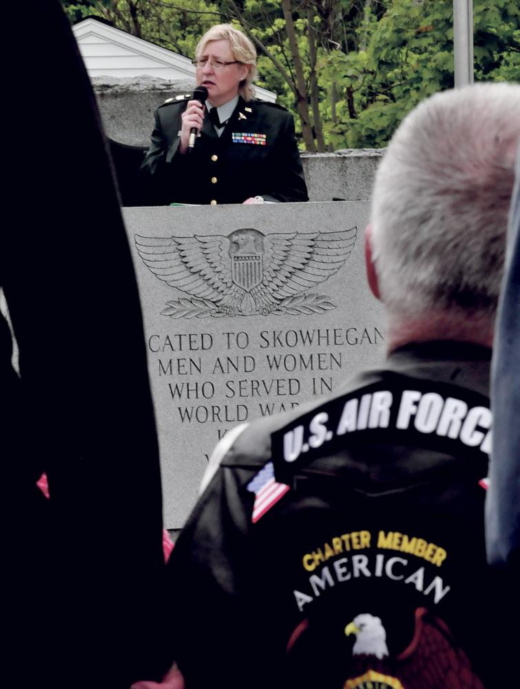 Staff photo by David Leaming HONOR: Susan Horsman, a 26-year veteran of the U.S. Airforce, was one of several speakers during a Memorial Day ceremony in Skowhegan on Monday, May 26, 2014.