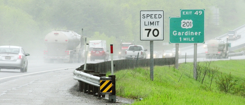 NEW SPEED: Cars on Interstate 295 head south past a sign showing newly raised speed limit on Tuesday May 27, 2014 in Gardiner.