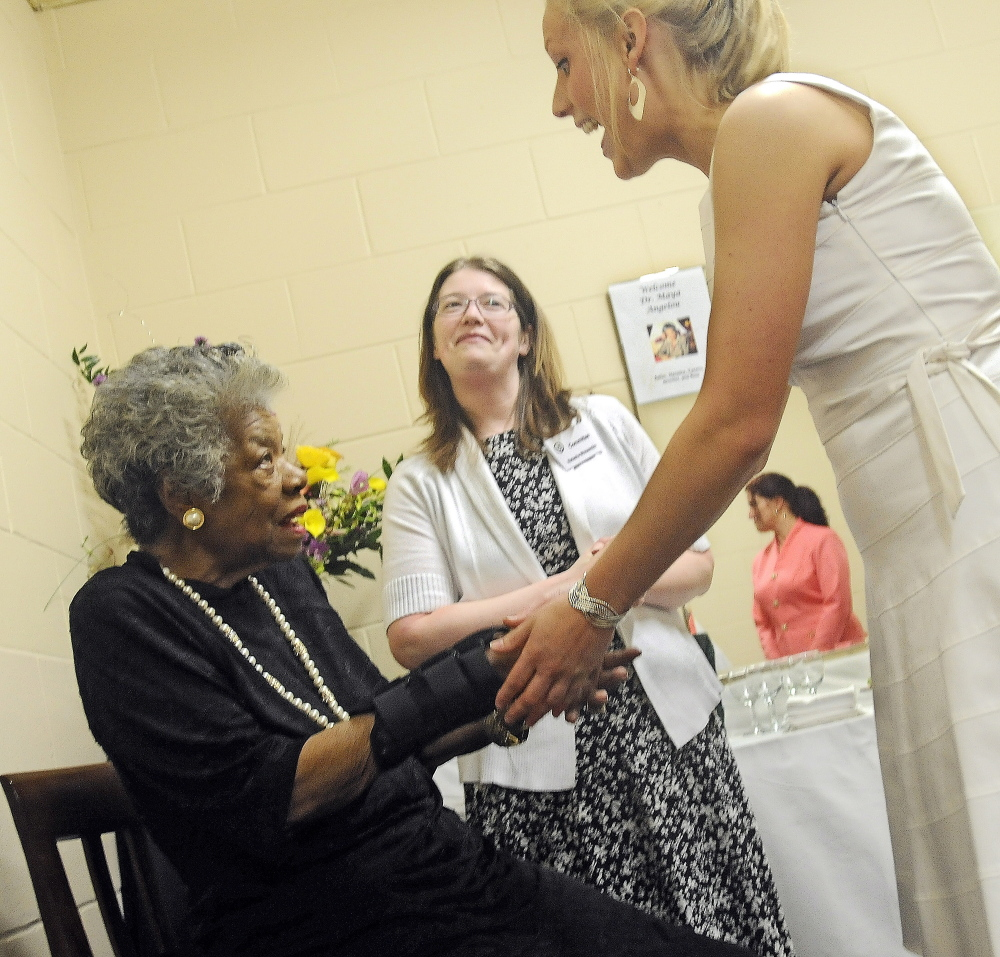 ANGELOY VISIT: Maya Angelou, left, greets University of Maine at Augusta students Jennifer Laney, right, Alice Ireland, and Natasha April 26, 2010 in Augusta.