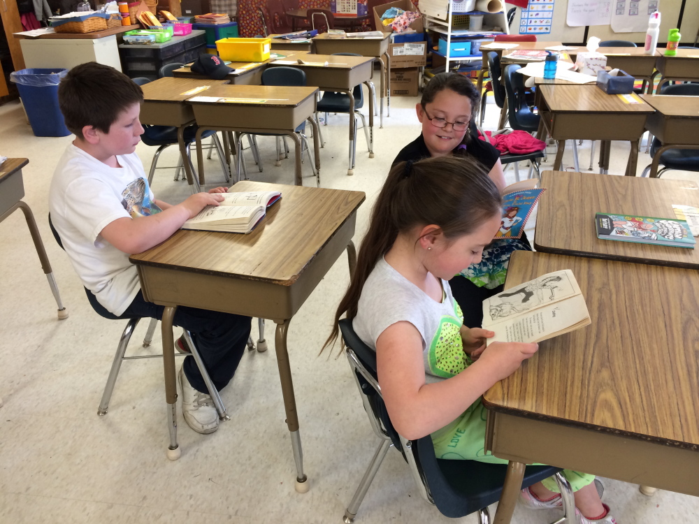 NEW GRADE: Third-grade students Jackie Dodge, front, Ahna Higgins and Troy Rodderick work on schoolwork at Bloomfield Elementary School in Skowhegan on Wednesday.