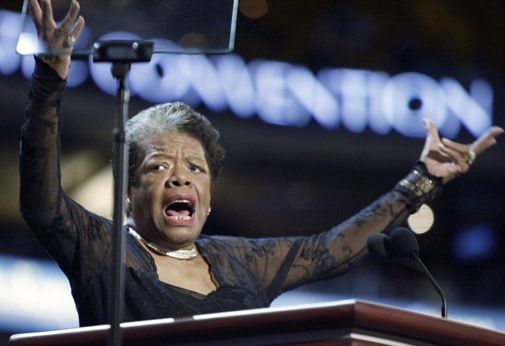 "Poet and activist Maya Angelou speaks on stage during the Democratic National Convention in Boston in July 2004. She wrote the poem ""On the Pulse of Morning"" for President Bill Clinton's inauguration in 1993."