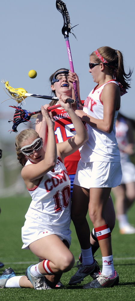Staff photo by Andy Molloy COLLISION COURSE: Cony's Alexis Dostie, left, and Hayley Quirion collide with Messalonskee's Ally Fischang Thursday in Readfield.