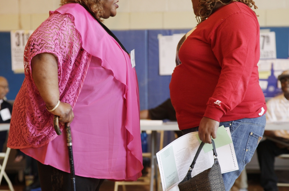 Two overweight women hold a conversation in New York in this 2012 photo. No country has been able to curb obesity rates in the last three decades, according to a new global analysis paid for by the Bill & Melinda Gates Foundation.
