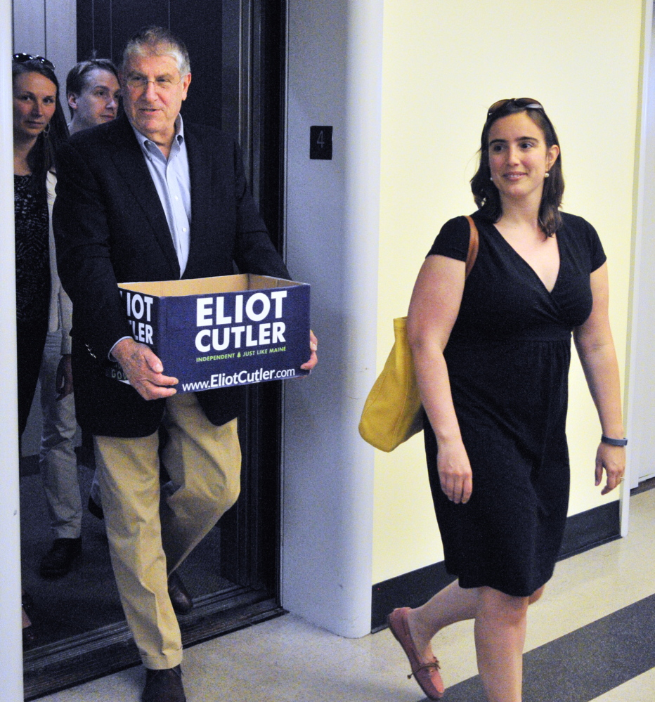 IT'S OFFICIAL: Independent candidate for governor Elliot Cutler, left, follows his deputy campaign manager Kaitlin Lacasse out of the elevator as they deliver petition signatures to the secretary of state's office on Thursday in Augusta.