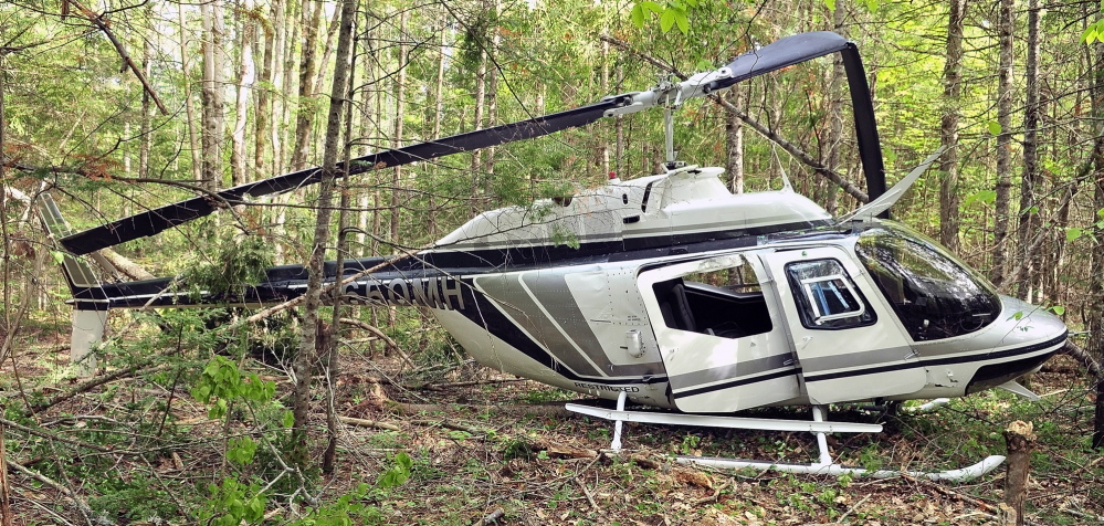 CRash site: A helicopter rests in the wood after a crash landing on Friday in Whitefield. The pilot, Mike Connolly, was not injured.