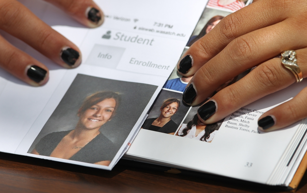 Sophomore Shelby Baum, 16, points to a Wasatch High School yearbook proof, left, and her altered yearbook photo, right, with a higher neckline drawn in.