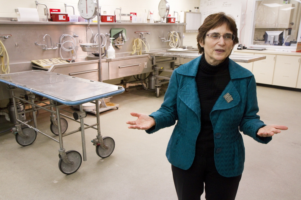 Dr. Margaret Greenwald talks about operations at the Office of Chief Medical Examiner inside the autopsy room in Augusta in April. Greenwald retired as Maine's chief medical examiner Friday, and the office was already struggling to find qualified medical staff.