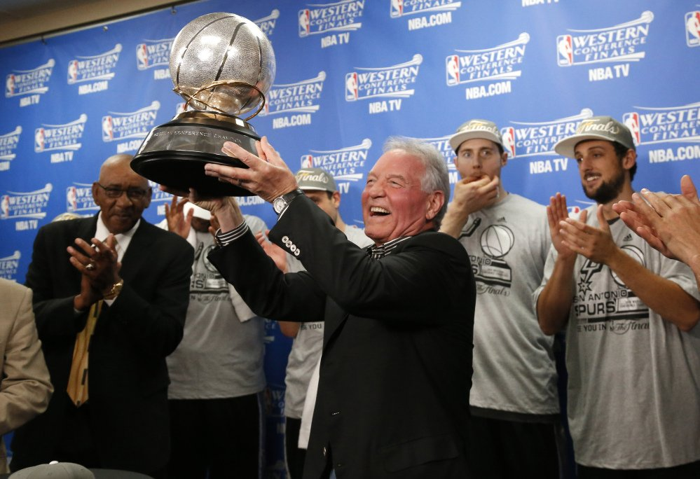 Spurs owner Peter Holt holds up the Western Conference trophy following Game 6 of the Western Conference finals Saturday night. The Spurs and Heat meet for the NBA championship for the second straight year. Miami won last year in seven games.