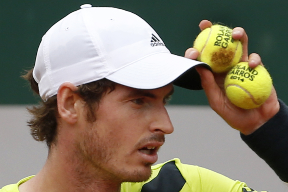 Britain's Andy Murray prepares to serve the ball during his third-round match at the French Open against Germany's Philipp Kohlschreiber on Sunday. Murray won in five sets 3-6, 6-3, 6-3, 4-6, 12-10.
