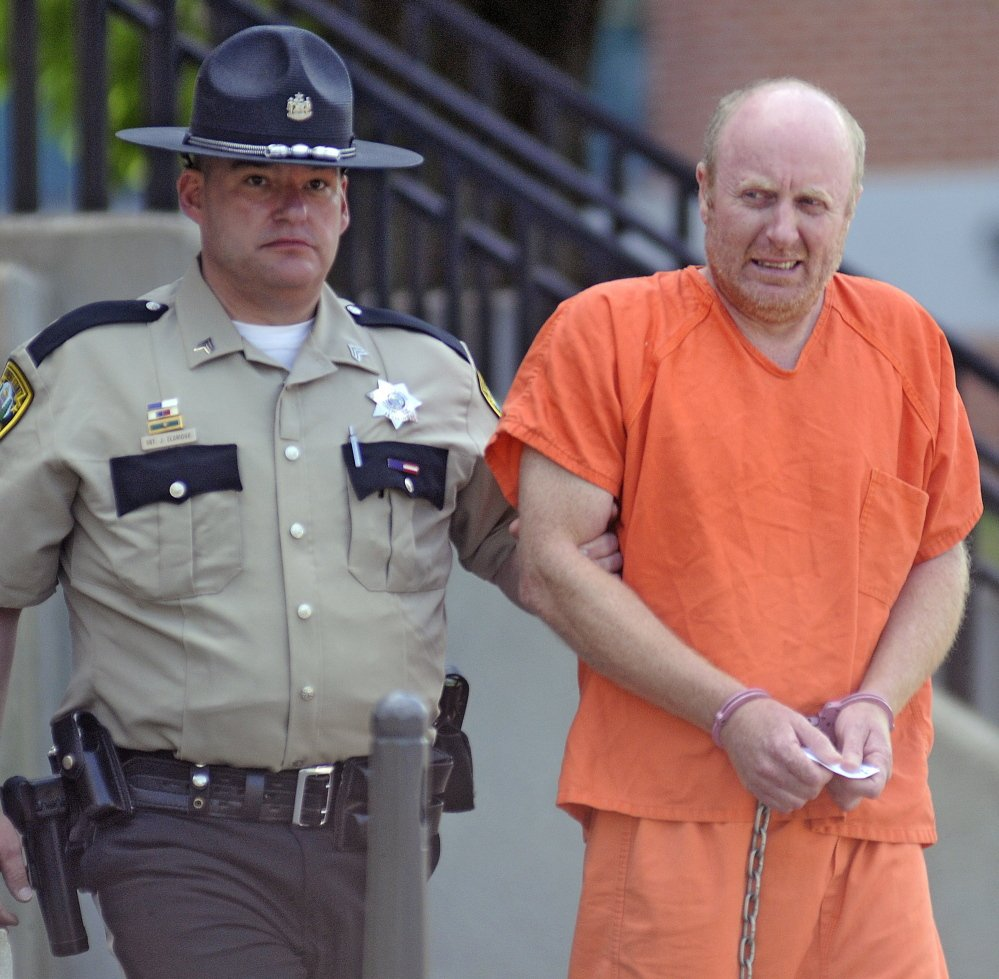 Staff photo by Andy Molloy   MURDER CHARGES: Roland Cummings, 44, appeared in Kennebec County Superior Court Monday.