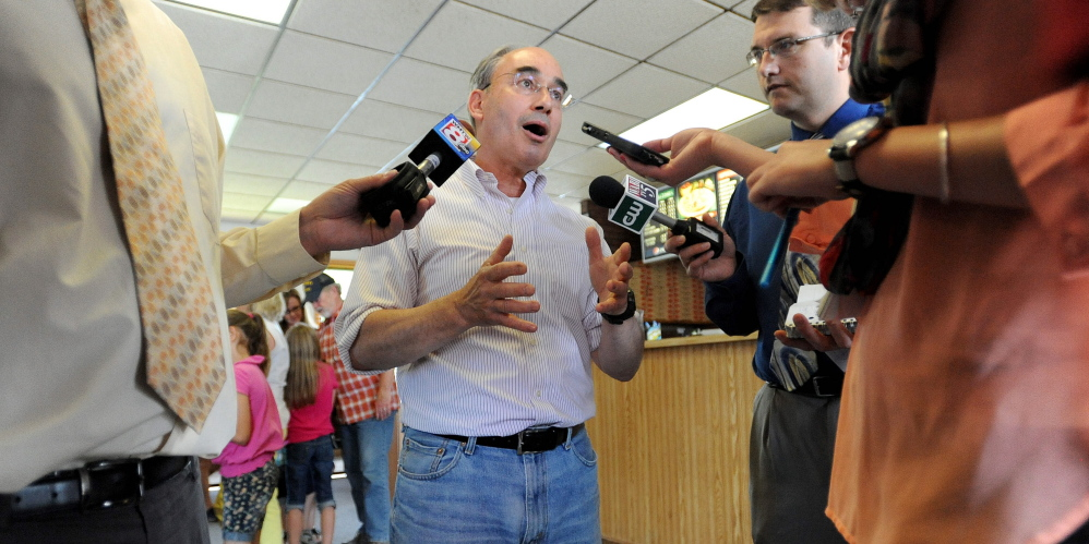 Campaign: Bruce Poliquin, Republican candidate for the 2nd Congressional District seat, speaks to reporters at the Oakland House of Pizza, in Oakland, on Wednesday, a day after he defeated Kevin Raye in the primary election.