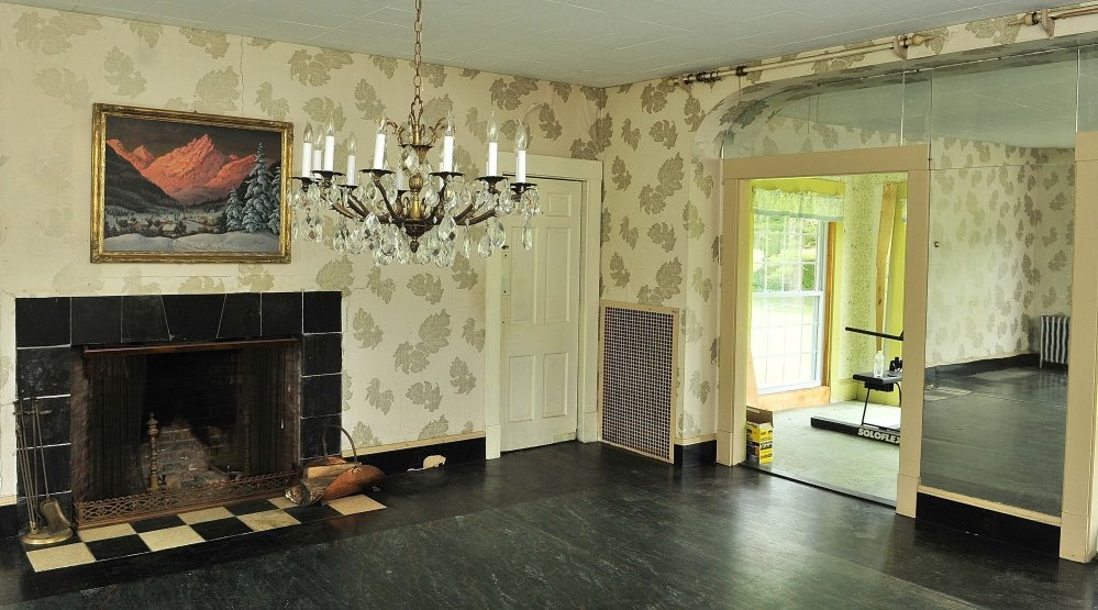 For Sale: The dining room which features a fireplace and chandelier at Maine Chance Spa. The estate was formerly owned by Elizabeth Arden is for sale now.