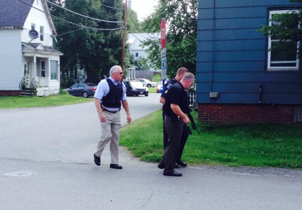 Waterville police Chief Joseph Massey, left, Deputy Chief Charles Rumsey, front, and Sgt. Lincoln Ryder look for evidence near the scene of a brief standoff on Spruce Street Friday morning. A man police believed armed with a handgun surrendered shortly after Waterville and Winslow police surrounded the house.