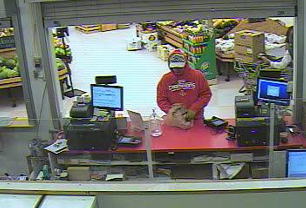 Contributed photo   An image released by police shows store surveillance of the robber.