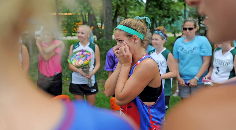 Messalonskee High School's Ally Leighton wipes tears from her eyes after presenting flowers to the Winthrop High School field hockey team during Play Day hosted by Winslow High School in Winslow on Saturday.