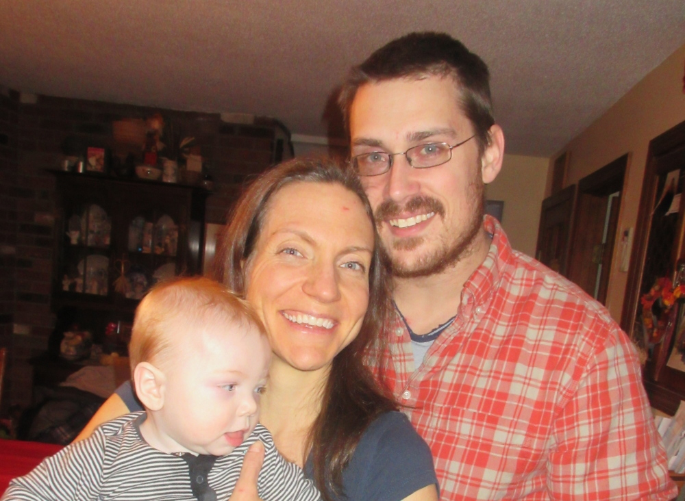 Contributed photo Carrie Young, of Winthrop, seen here with her husband David and son Eliot, has severe chemical sensitivities, which make it impossible for her to work in an office.