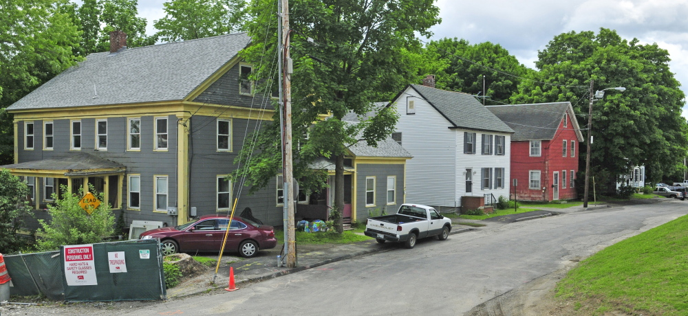 A house on Court Street and three houses on Perham Street, seen here in June, may be demolished to make room for more parking for0 the Kennebec County courthouse. The Augusta Planning Board discusses the issue Tuesday night .