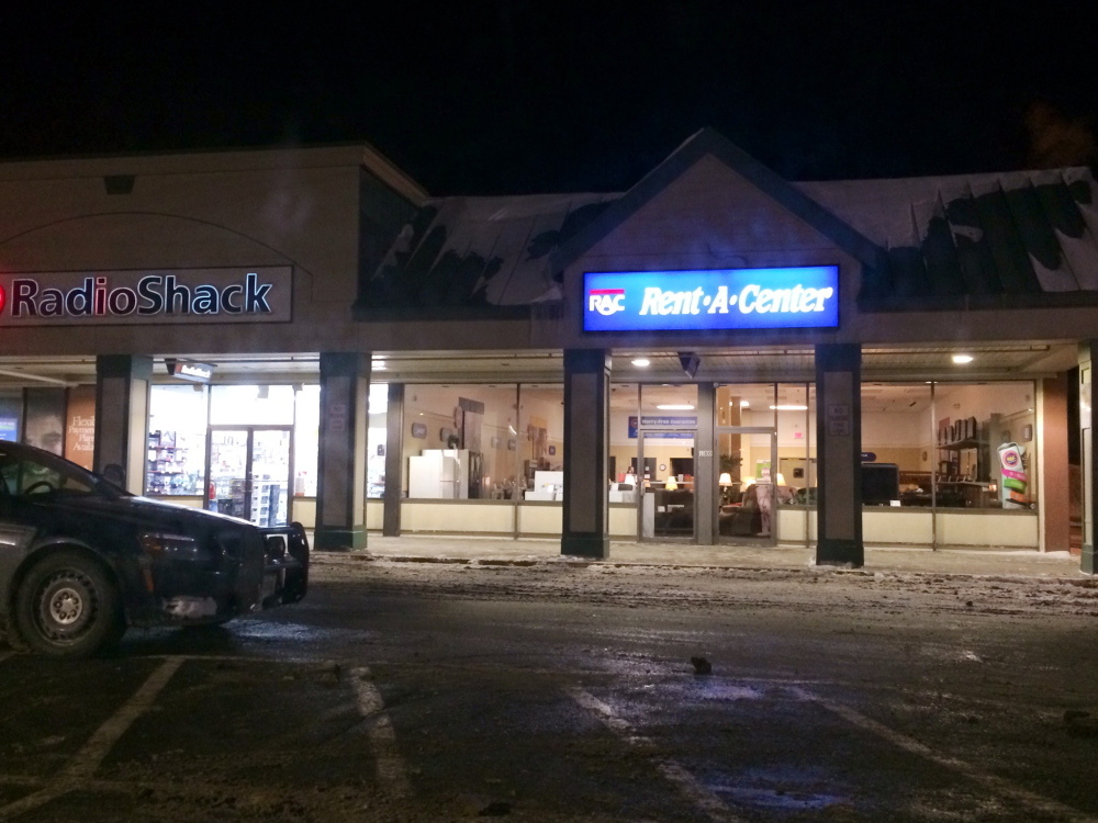 A masked gunman robbed the manager of the Rent-A-Center store in the Elm Plaza shopping area off  upper Main Street in Waterville at about 7:30 p.m. Police say the man showed a black handgun and took off with the store's bank deposit bag.