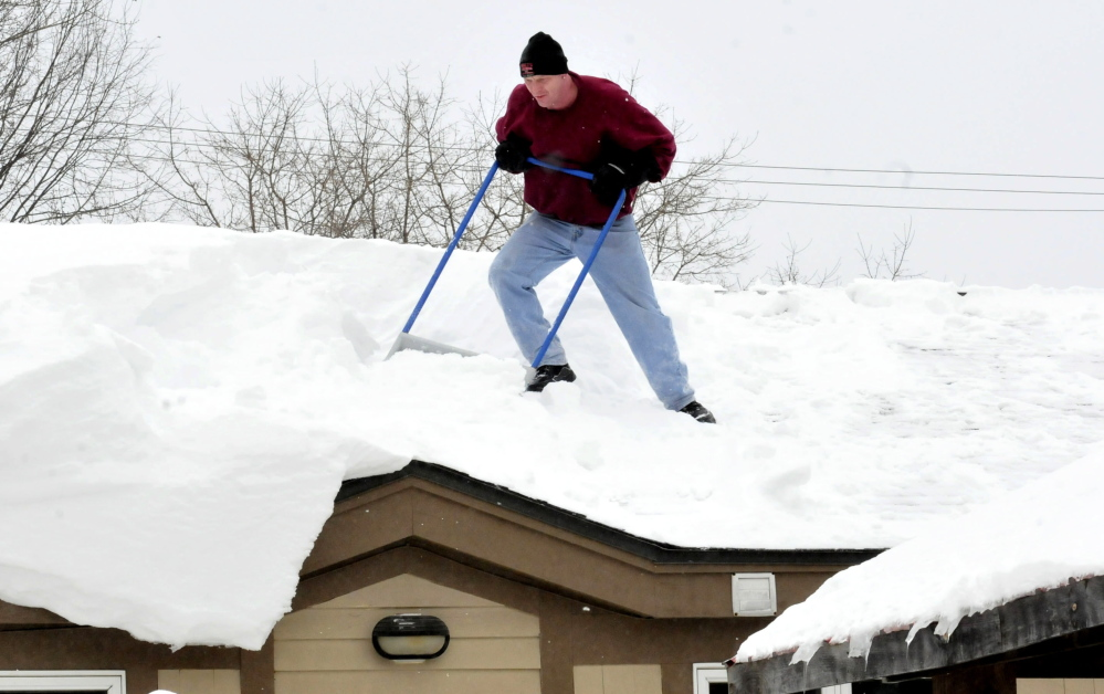 Mike MacDonald Struggles Against Deep Snow While Shoveling Off The Roof Of  A Building In Waterville
