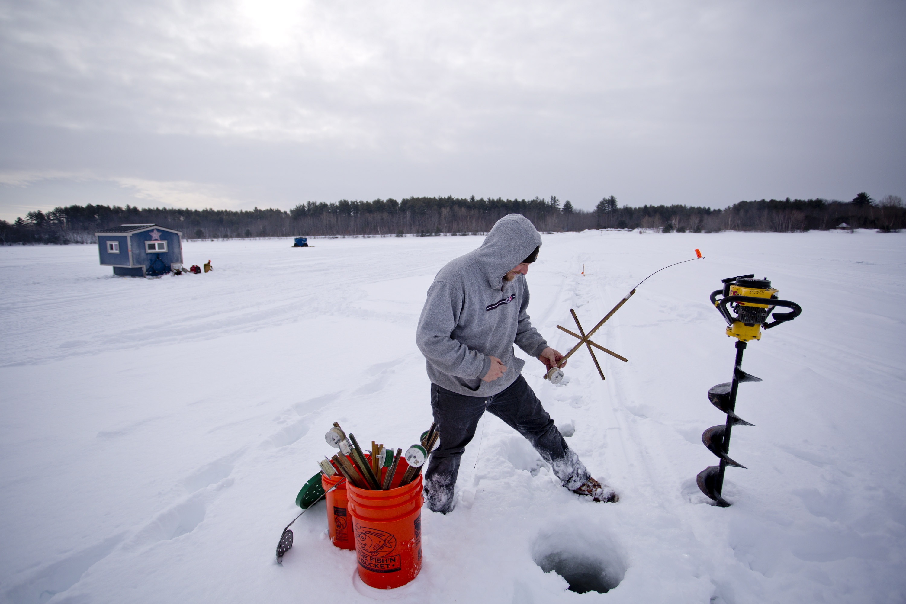 Only the hardiest anglers turn out for sebago lake ice for Ice fishing maine
