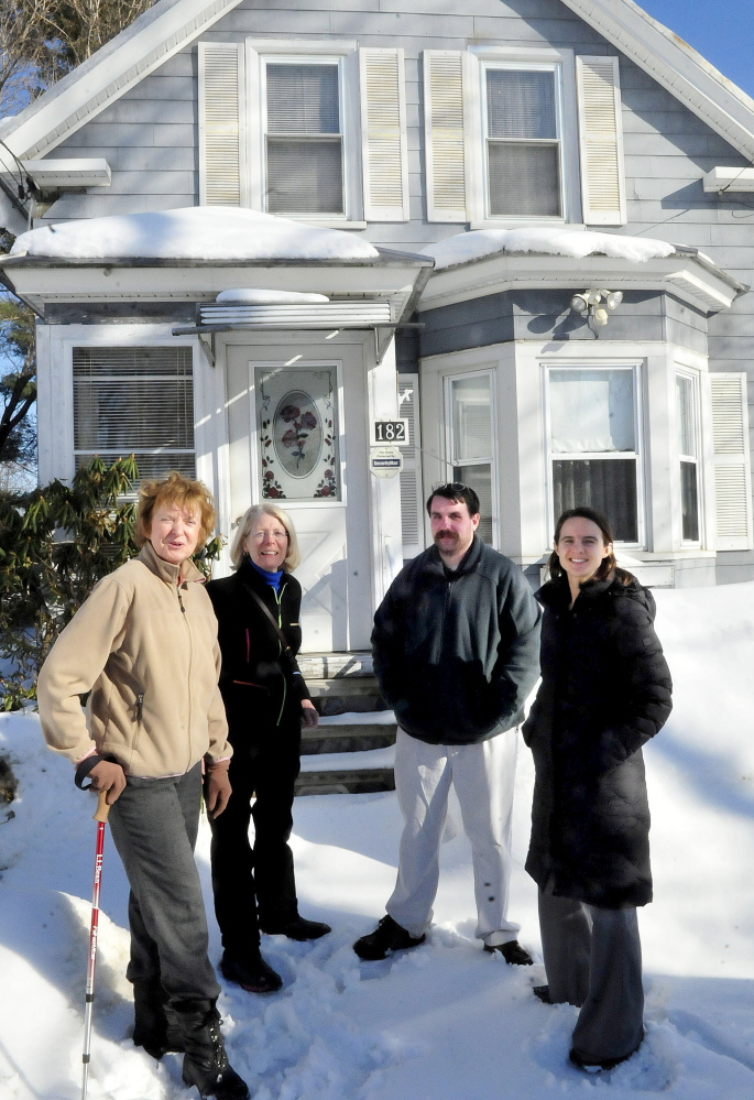 Staff photo by David Leaming This home in Waterville may be the first bought by members of the Waterville Community Land Trust. The trust has an option to buy the home for $60,000 and and then refurbish it at an additional cost. At the home on Wednesday, from left, are Nancy Williams, City Planner Ann Beverage, Scott McAdoo and board chairwoman Ashley Pullen.