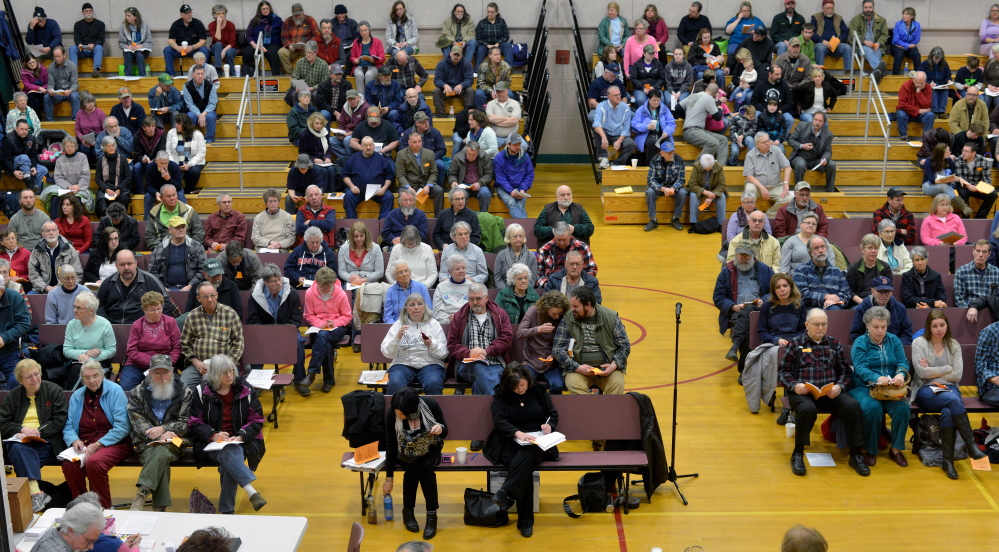 Voters participate in the Town Meeting at the New Sharon Elementary School on Saturday.