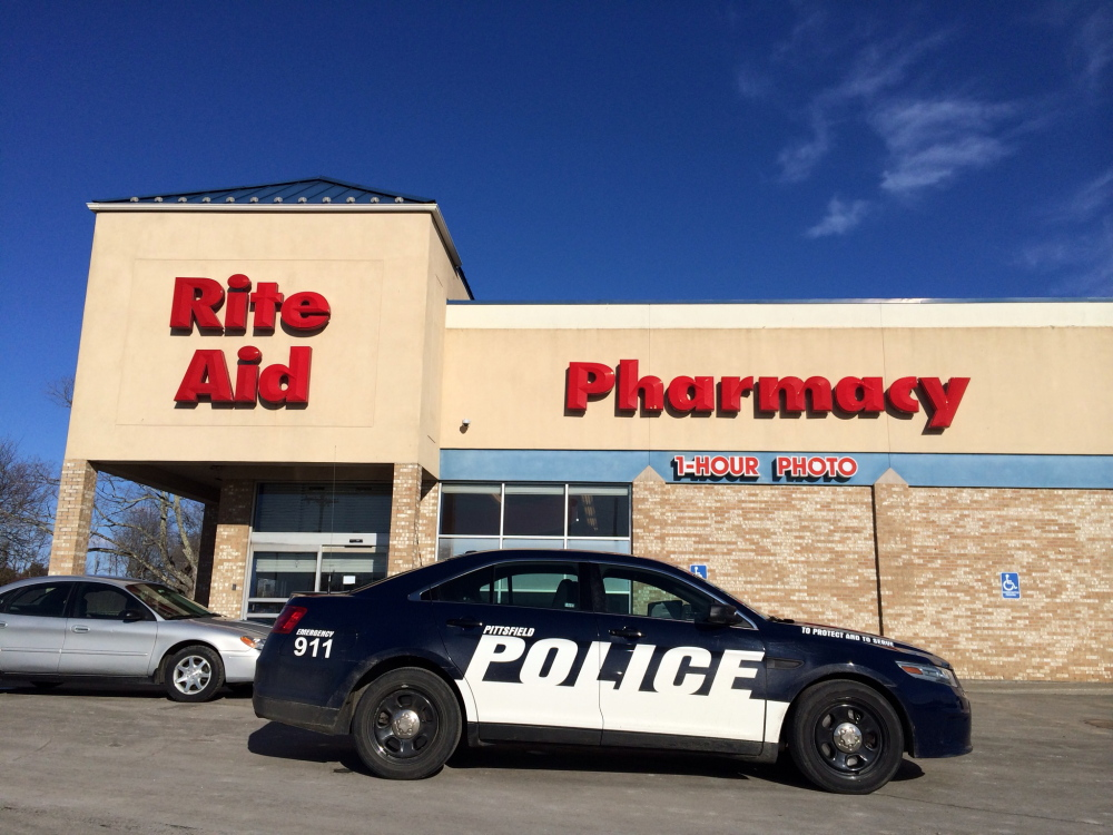 A police cruiser from nearby Pittsfield stands outside the Rite Aid Pharmacy in Newport after a robbery there Tuesday afternoon.
