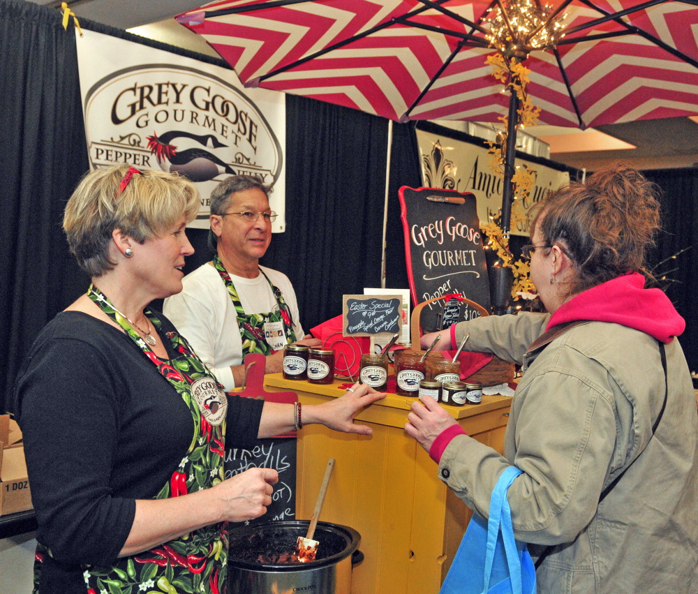 Sandra Dwight-Barnes, left, and Norman Barris talk to Jeanne Grimes about their Grey Goose Gourmet Pepper Jellies on Saturday at the Kennebec Valley Community College and 107.9 Mix Maine Culinary Festival in the Augusta Civic Center. Dwight-Barnes said she started her company one year ago with a recipe that came from her mother.