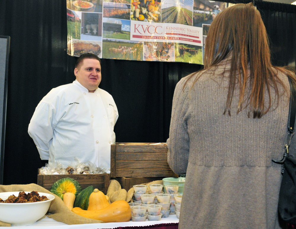 Kennebec Valley Community College culinary student Mike O'Brien chats with a showgoer Saturday at the college's booth at the Kennebec Valley Community College and 107.9 Mix Maine Culinary Festival in the Augusta Civic Center.