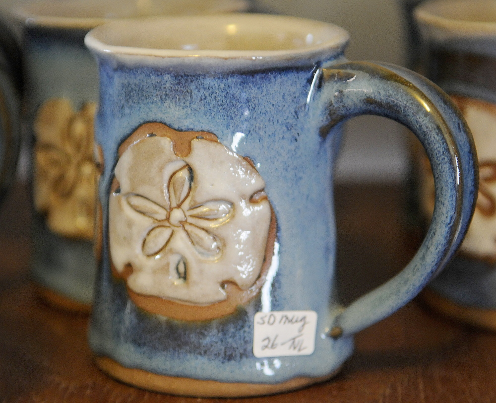 A mug stands on display Sunday at Loken Pottery in Farmingdale. Barbara and Neal Loken opened their studio for tours during the Maine Pottery Tour, as did several other shops in Maine.