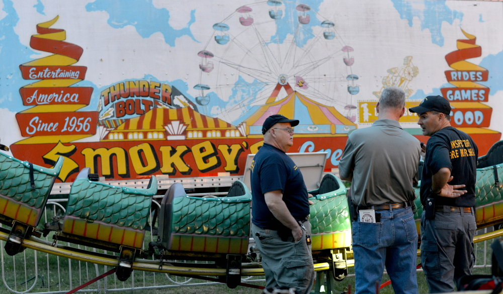 "Inspectors from the Office of the State Fire Marshal investigate a ride malfunction of the Dragon Wagon at the Smokey's Greater Show carnival at Head of Falls in Waterville on June 12. The Office of the State Fire Marshal on Monday charged Arthur Gillette, 49, of Pittsfield, Massachusetts, the carnival's ride supervisor, with falsifying physical evidence because he ""was attempting to repair or alter the physical condition of the ride before we were able to get there to investigate it,"" according to Sgt. Ken Grimes."
