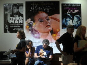 People gather in the Railroad Square Cinema lobby on Thursday in Waterville to buy tickets for movies at the 18th annual Maine International Film Festival.