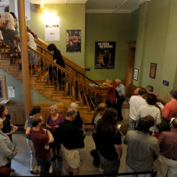 """People wait in line Friday night in the Waterville Opera House hallway for the movie """"Tumbledown"""" to kick off the opening night of the Maine International Film Festival in Waterville."""