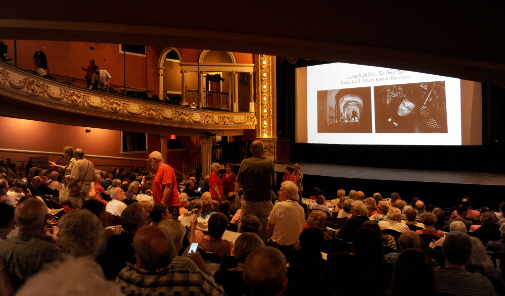 "People take their seats Friday night in the Waterville Opera House for the showing of ""Tumbledown"" during the opening night of the Maine International Film Festival in Waterville."