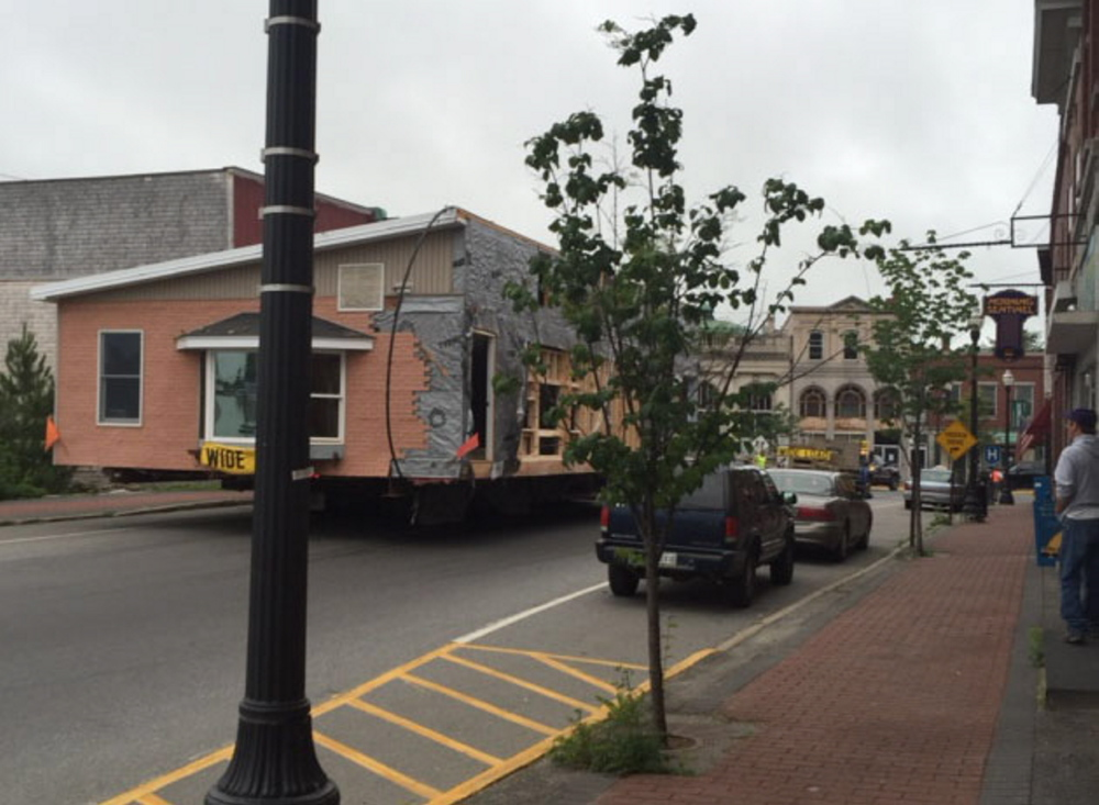 A portable building is moved at 6:30 a.m. Wednesday down Madison Avenue in Skowhegan. The building was on its way to the campus of Skowhegan Area High School, where it will house the new Kennebec Valley Community Action Program early-childhood center. Another portion of the building will be moved Friday morning.