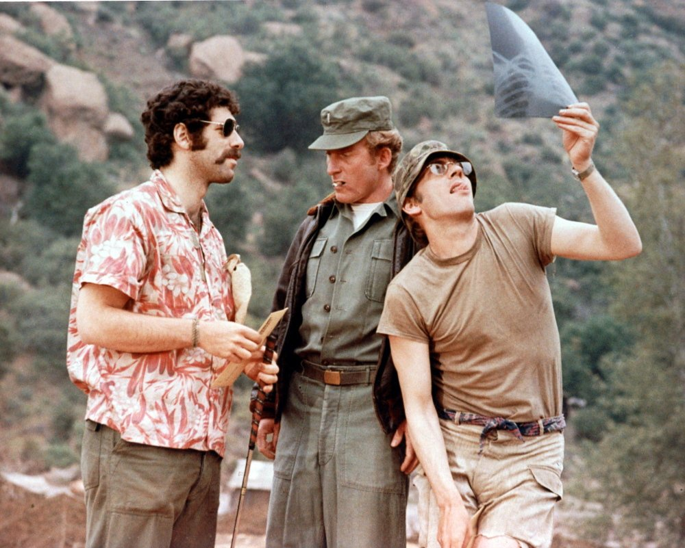 "From left are Elliot Gould, Robert Duvall and Donald Sutherland in a scene from ""M*A*S*H."""